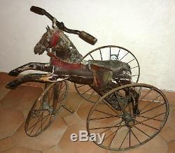 Ancien tricycle du XIX ème Cheval en bois et fonte Napoléon III jouet horse