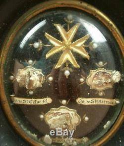 BEAU RELIQUAIRE CADRE OVALE NAPOLEON III CONTENANT 3 RELIQUES CACHET CIRE XIXe
