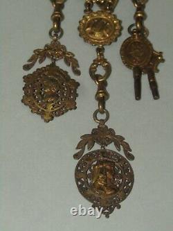 Chatelaine porte-montre gousset pomponne métal doré XIX EME