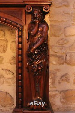 Cheminée en noyer sculpté, XIXe