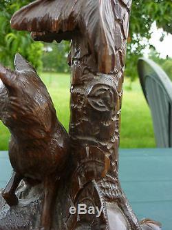 Forêt noire Vase pied en bois sculpté, tulipe en cristal gravé. XIXe s