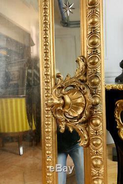 MIROIR À PARECLOSES D'ÉPOQUE NAPOLÉON III EN BOIS DORÉ DE 156 CM HAUTEUR XIXe