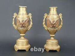 Paire de cassolettes formant bougeoirs en bronze doré XIX ème s