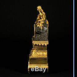 Pendule La lectrice en bronze doré, XIXe